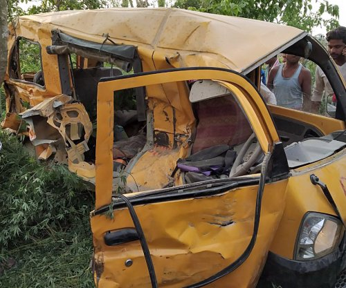 13 children killed in India after train hits school van