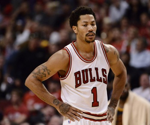 Chicago Bulls cut two players; Derrick Rose iffy for opener
