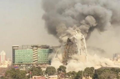 Dozens dead after Tehran high-rise collapses in fire