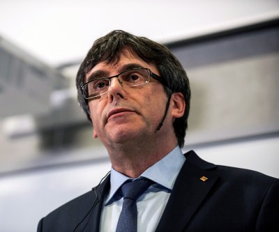 Wanted ex-Catalan leader Puigdemont surrenders to Belgian authorities