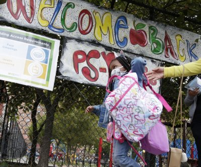 Children return to NYC schools; U.S. adds 33K COVID-19 cases