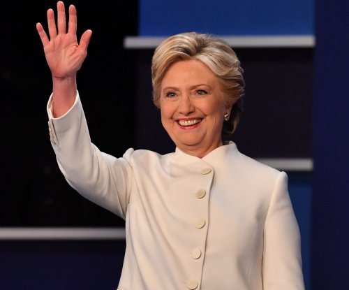 Hillary Clinton delights with white pantsuit at final debate