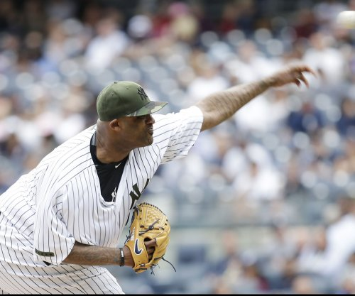 New York Yankees ride arm of CC Sabathia to edge Boston Red Sox