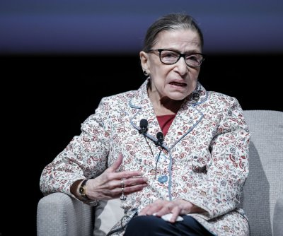 Ginsburg absent at Supreme Court due to illness