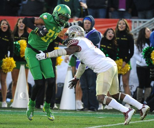 Reports: Oregon Ducks' WR Carrington suspended for title game