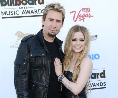 Chad Kroeger spotted sans wedding band as split announced