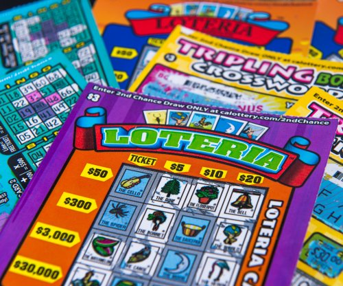 Cancer survivor wins $77,777 from Indiana lottery