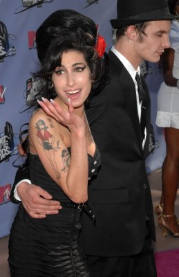 Winehouse's ex in coma after overdose