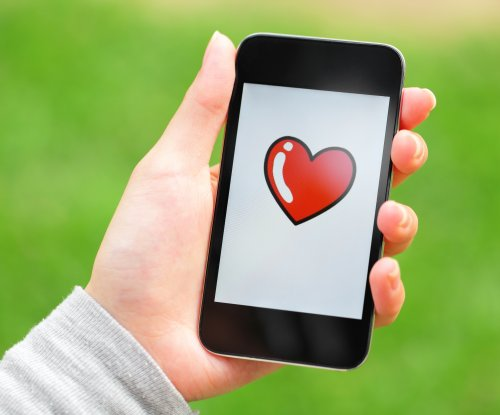 Heart emoji named Top Word of 2014