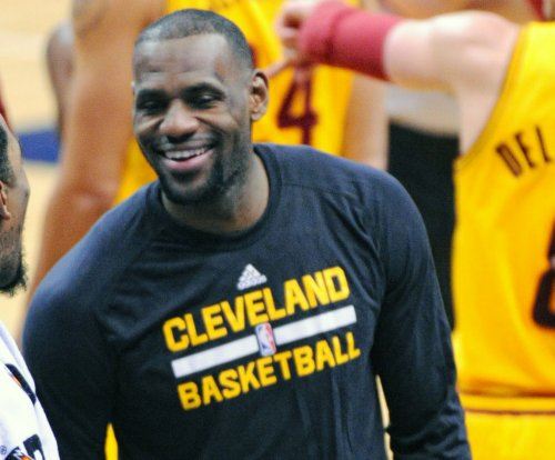 LeBron James reaches milestone; Cleveland Cavaliers edge Philadelphia 76ers