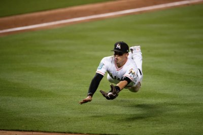 Marlins' Prado makes diving catch on bunt, going from third to first-base line