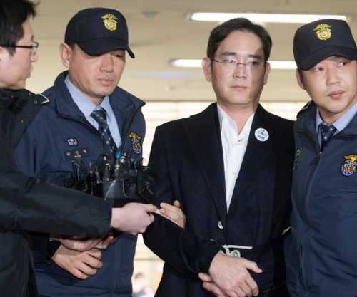 Samsung head denies bribery charge in court