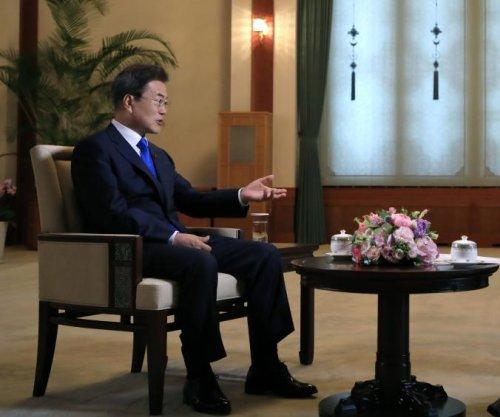 President Moon lauds U.S.-North Korea summit, calls for concrete action