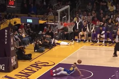 Warriors' Stephen Curry slips and falls on wide-open dunk attempt