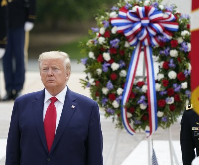 Trumps lay wreath as Memorial Day observances adapted nationwide