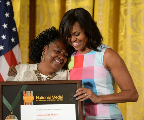 Michelle Obama presents National Medal to 10 libraries, museums