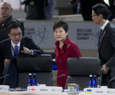 South Korea leader apologizes for affiliation with woman suspected of corruption