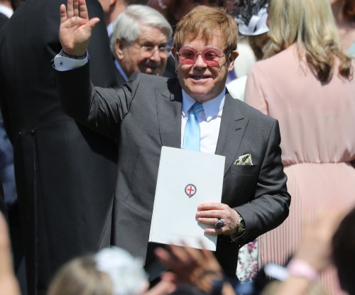 Elton John sings 'Circle of Life' at Prince Harry's wedding reception