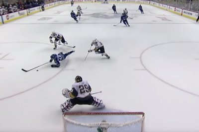 Canucks' Elias Pettersson gets no-look assist while falling