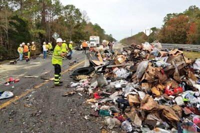 Truck crash covers highway in shirts, shoes