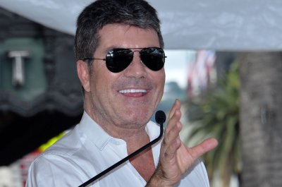 Simon Cowell undergoes surgery after breaking back in bike mishap