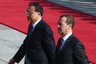 China's Xi, Russia's Medvedev stress improved relations