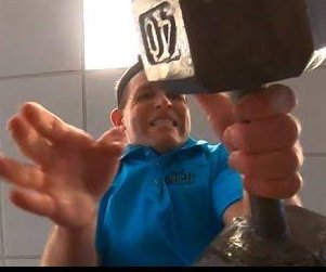 Man transfers 40 pounds from hand to hand 100 times in 21 seconds