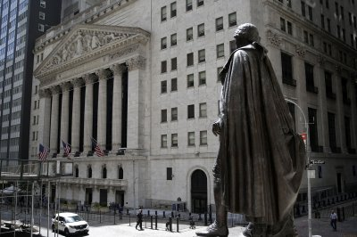Tech drags Dow down 405 points, oil prices fall amid crude buildup