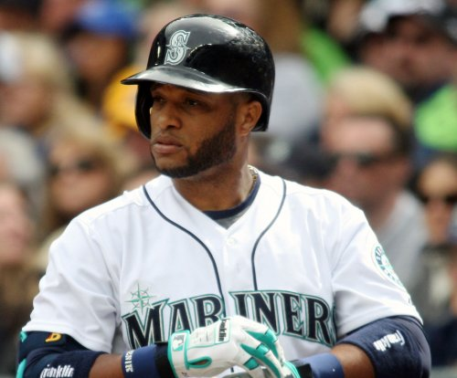 Seattle Mariners' Cano hit by throw in dugout, leaves game
