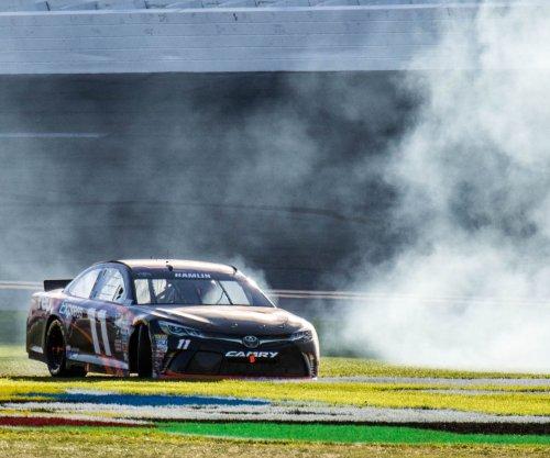 Denny Hamlin uses fresh tires to win Xfinity race at Charlotte