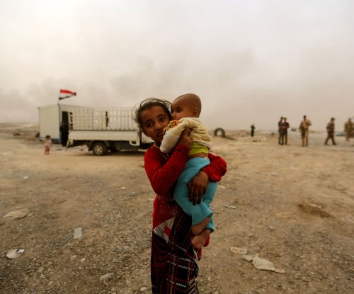 Children born in Mosul do not have citizenship; Islamic State accused of prisoner massacre