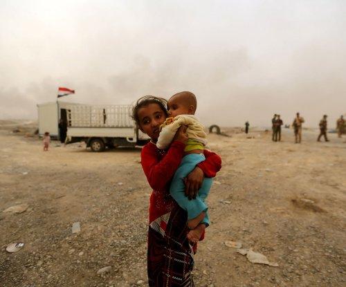 Children born in Mosul do not have citizenship; Islamic State accused of prisoner massacre