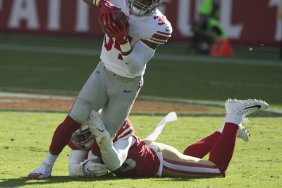 49ers easing Foster back into fold