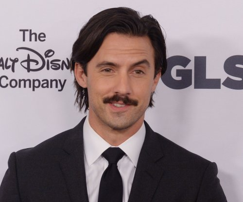 Milo Ventimiglia performs push-ups with Ellen DeGeneres on his back on 'Ellen'