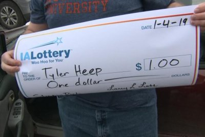 Iowa man gets giant check for $1 lottery win