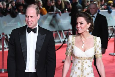Kate Middleton re-wears gown to BAFTAs with Prince William