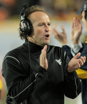 Holgorsen has new deal with West Virginia