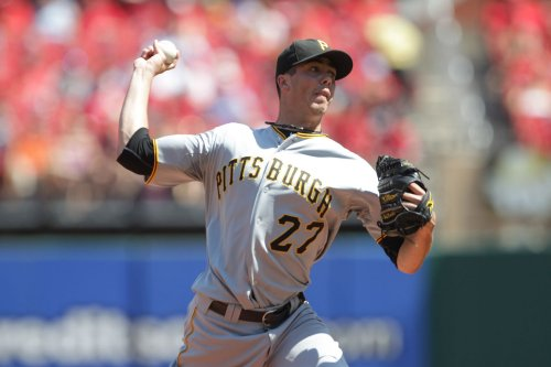 Pirates keep starter Karstens on staff