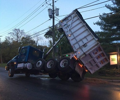 New Jersey dump truck gets strung up by electrical wires