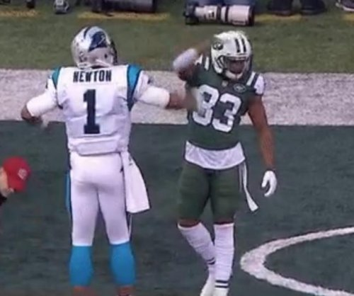 Panthers' Cam Newton scores TD and does Superman pose, shoved by Jets' Jamal Adams