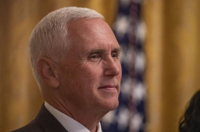 Pence makes unannounced visit to troops in Iraq