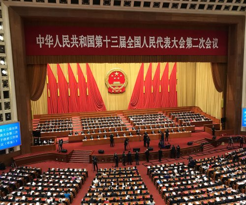 China condemns Hong Kong's electoral system at National People's Congress