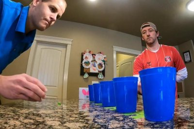Idaho men bounce Ping-Pong balls into 5 cups for Guinness record