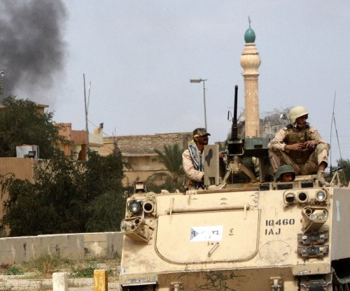 Clashes in Iraq continue as U.S., Russia expand Syria air bases