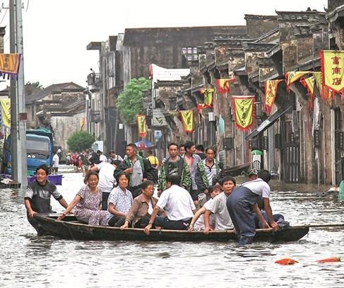 Flooding kills hundreds in China, Pakistan, India