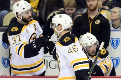 Boston Bruins' David Krejci leaves with upper-body injury vs. Vancouver Canucks