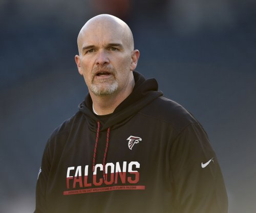 Falcons coach Dan Quinn, players make USO trip