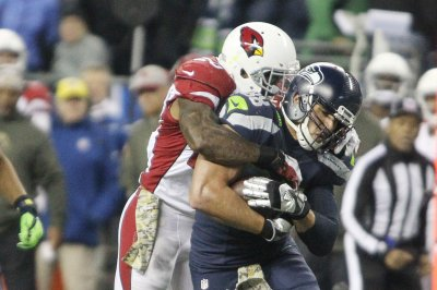 Cardinals LB Bucannon misses practice with hyperextended knee