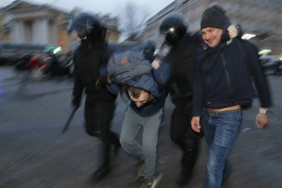 Russian riot police arrest 1,700 during rallies to support Alexei Navalny