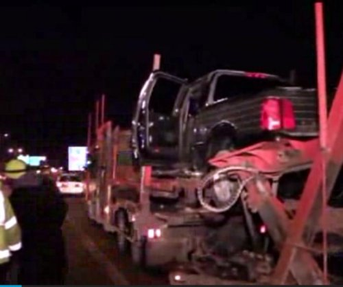 Pickup truck boards car carrier on Illinois highway